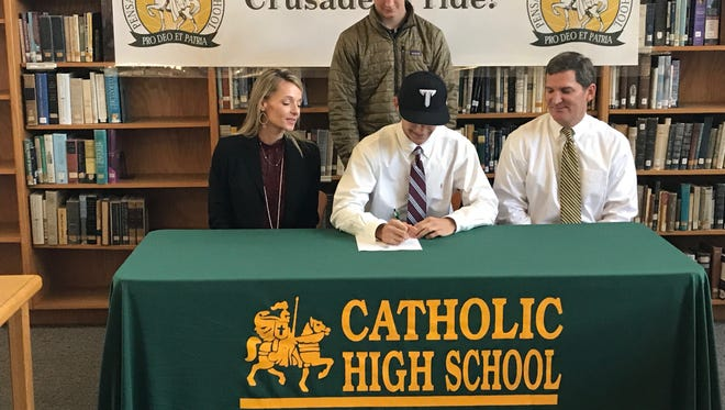 Catholic High's Donovan Whibbs signs his letter of intent to Troy, accompanied by mother Suzanne Whibbs, father Donovan Whibbs and brother Colin Whibbs.