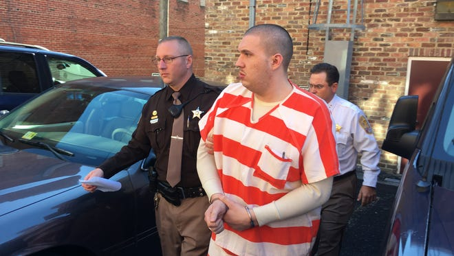 Steven T. Decker is led away Thursday from the Staunton Courthouse after being sentenced for killing his 6-year-old son.