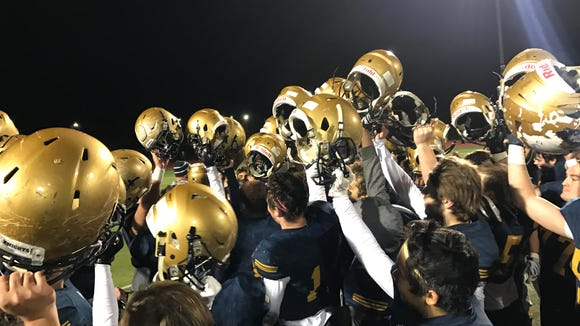 NV/Old Tappan celebrates after beating Wayne Hills, 42-7, in the North 1, Group 4 semifinals on Friday.