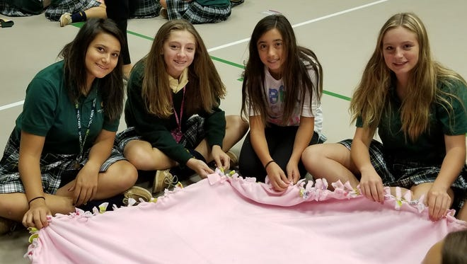 Our Lady of Mercy Academy's Interact Club, with a little help from current and prospective students, made blankets for Project Linus.