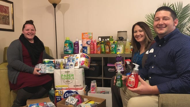 From left, Hope House of Manitowoc County Director Erin Schultz accepts personal and home care items from UnitedOne Credit Union Products & Services Manager Amy Nelson and Director of Branch Operations Ryan Manis on Nov. 6. The items were collected during UnitedOne's Family Care Drive in October.