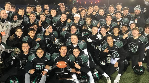 Yorktown celebrates after defeating Burnt Hills 34-19