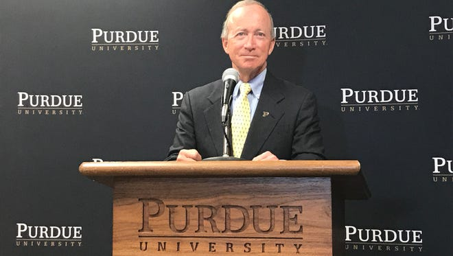 Purdue University President Mitch Daniels announcing a new program to help middle income families Tuesday, Nov. 21 in Indianapolis.