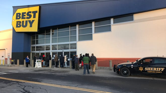Shoppers wait outside of Best Buy awaiting an 8 a.m. opening on Black Friday.