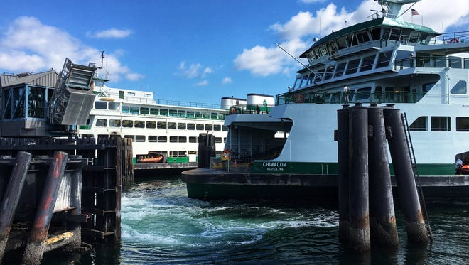 Thee Chimacum approaches the Bremerton dock next to the Kaleetan. The vessel, newest in the state ferries' fleet, has been criticized for weak cell service.