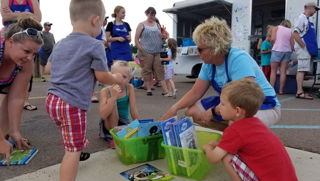 Great Falls Public School's Elementary Assistant Superintendent K-6 Ruth Uecker volunteering at the Summer Read 6 book trailer, two years ago.