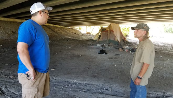 Shawn Doney, left, who does homeless outreach with St. Vincent de Paul, visits the 28 homeless camps in the area. He checks on the people's health, gives them food and clothing and makes sure they know about the resources that they can get at SVDP.