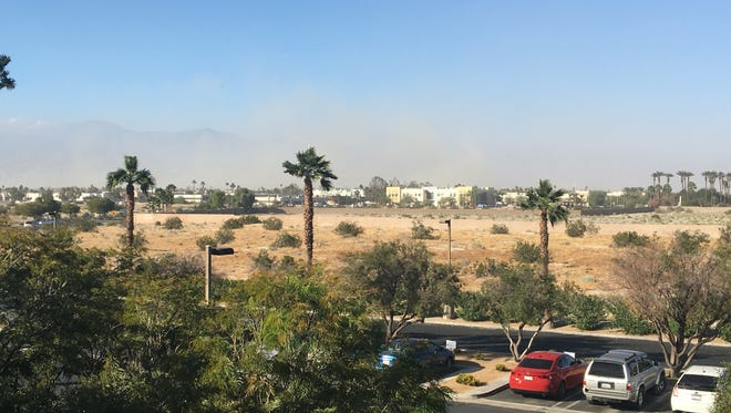 Blown sand limits visibility in the Coachella Valley Monday. The area is under a wind advisory scheduled to last all day.