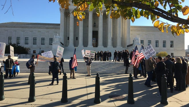 Demonstrators opposed to current patent review procedures protested outside the Supreme Court Monday as the justices heard a major patents case.