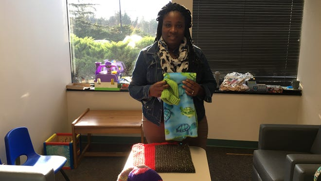 Yu Quishia McKinney accepted our baby blankets and hats on behalf of the Division of Child Protection and Permanency office in Piscataway.