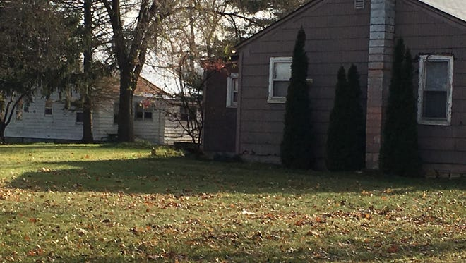 Two city-owned houses in South Lyon's McHattie Park. The home in foreground isn't habitable, the other home has a tenant.