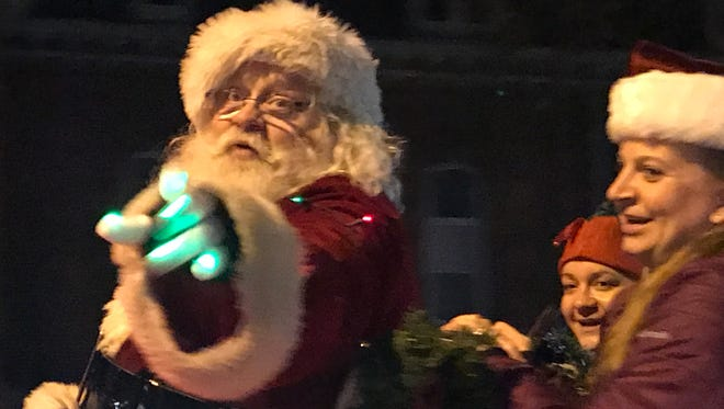 Santa was the main attraction of Saturday's Light up the Grand holiday parade through downtown Farmington.
