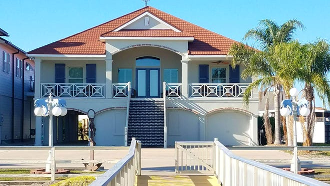 This 5 bedroom, 51/2 bath home is located at442 Bayview Drive inCypremort Point. It is listed at $1,580,000.
