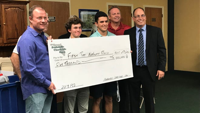 Pensacola's Joe Durant, a PGA Tour and PGA Tour Champions player, joins with Catholic High sophomore Nicholas Dimitroff and West Florida senior Ty Aulger, along with Pensacola movie theater owner Nels Offerdahl and Pensacola businessman and tournament director John Peacock in presenting First Tee of Northwest Florida at $5,000 check from the 16th annual Panhandle Charitable Open in September that has benefited a variety of causes.