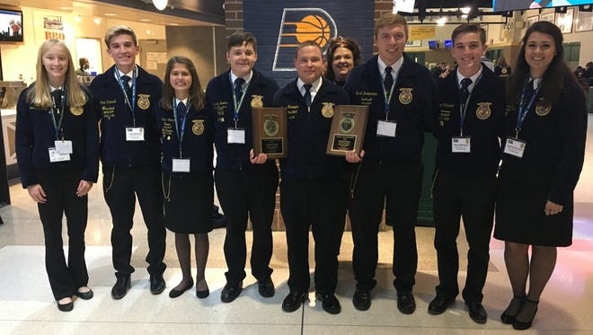 Aaron Lane Hendrich of Eaton - pictured with other Ohio FFA members - was the national winner of theFFA Agricultural Mechanics Repair and Maintenance - Entrepreneurship Proficiency Award.