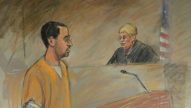 A sketch shows Larry Nassar and U.S. District Court Judge Janet Neff on Thursday, Dec. 7, when he was sentenced to 60 years in federal prison on child pornography charges.