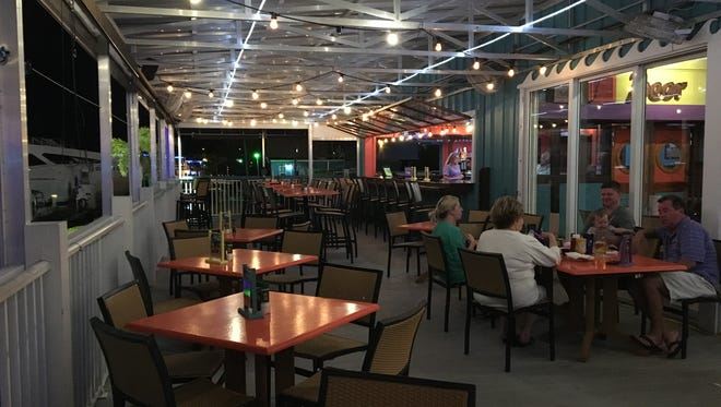 The Original Shrimp Dock Bar & Grill on San Carlos Island at Fort Myers Beach offers a waterfront dining experience to delight your family members who will visit during the holidays.