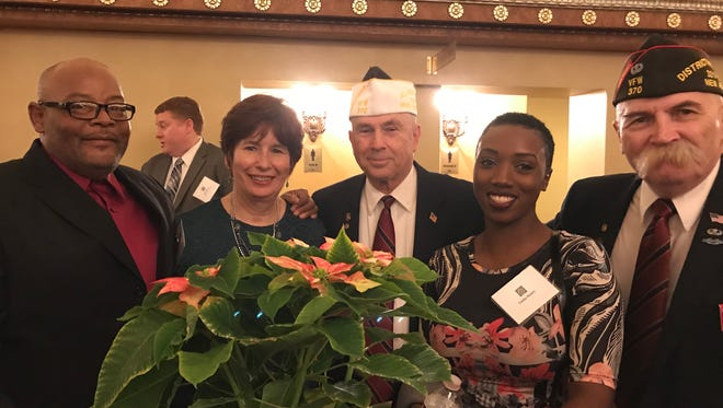 Middlesex County Regional Chamber of Commerce President Lina Llona (second from left) with members of VFW Post 370 of New Brunswick. With her are (from left) Henry Busby, Bill Young, Linda Henry and Bob Porter.
