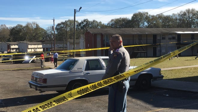 Hattiesburg police respond to a shooting at Bonhomie Apartments on Monday.