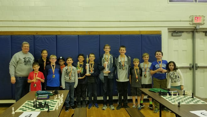Pictured from left to right: Tom Andrea, Chess Club Advisor; Sean Gyongyosi; Olivia Maizys; Michael Blackman-Thompson; Tyler Osborn; Damian Jiosi; Dante Rodriguez, Third Place, Matthew Deamer, First Place; Joseph Brewster, Second Place; Luke Shore; Thomas Werner, Nicholas Werner, Matthew Weir and Lexie Weir.