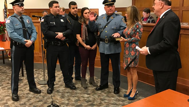 Angelo Calabro is sworn in by Mayor Daniel Mahler with his family after being promoted to police captain in Wanaque on Dec. 11, 2017.