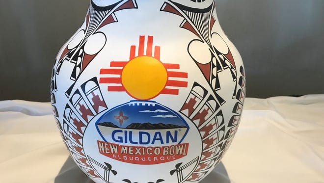 The New Mexico Bowl trophy is created by local artists Elizabeth and Marcellus Medina with a unique look each season.