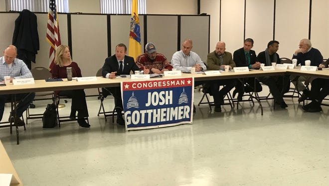 Rep. Josh Gottheimer (center) holds a summit with Bergen and Passaic County elected officials on Dec. 16 in Westwood.