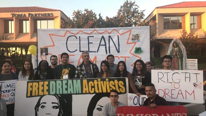 A group of protesters stood outside Arizona Senator Jeff Flake's office on Monday, Dec. 18, 2017.