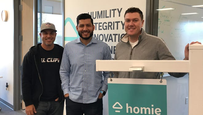 Mike Trionfo, left, Mike Peregrinar and Johnny Hanna co-founded Homie, a Draper-based tech startup looking to shake up Utah's real estate services industry.