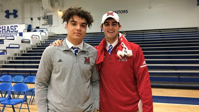 CovCath senior Kam Butler, left, and AJ Mayer during Covington Catholic's football signing ceremony for AJ Mayer and Kameron Butler Dec. 20, 2017 at the CovCath gymnasium, Park Hills KY. Both players signed with Miami of Ohio.