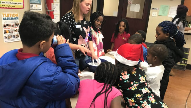 Students from the Laurelwood community interact with their University of Indianapolis mentor during an activity on December 14, 2017.