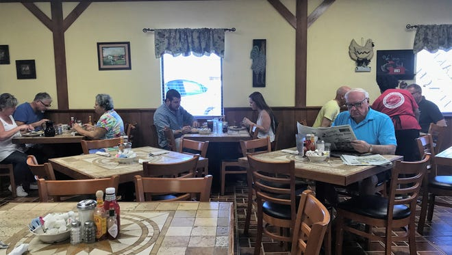 Customers eat breakfast at the Country House Restaurant off Davis Boulevard in Naples.