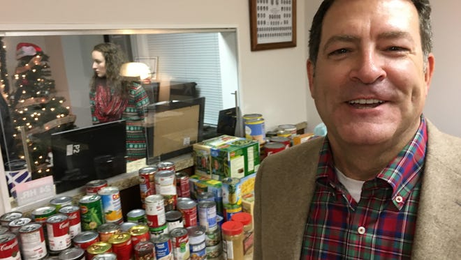 State Sen. Mark Green talks about food items constituents brought to the opening of a campaign headquarters in Clarksville for his Congressional campaign in December 2017.