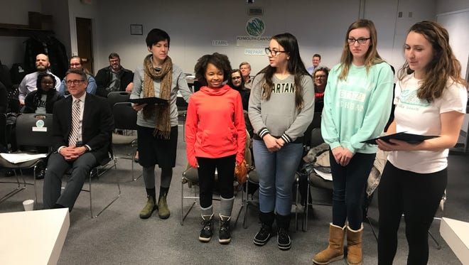 Arts academy advisor Amy Willacker-Brown (left) and student advisory council members Marquette Winston, Kaia Thomas, Madelyn Turrill and Sam Klozik accepted accolades from the Plymouth-Canton Board of Education.