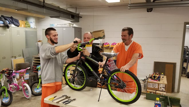 Two Inmates at the Ottawa County Detention Facility gave back to the community by helping build bicycles the Sheriff's Office donated to children in need.