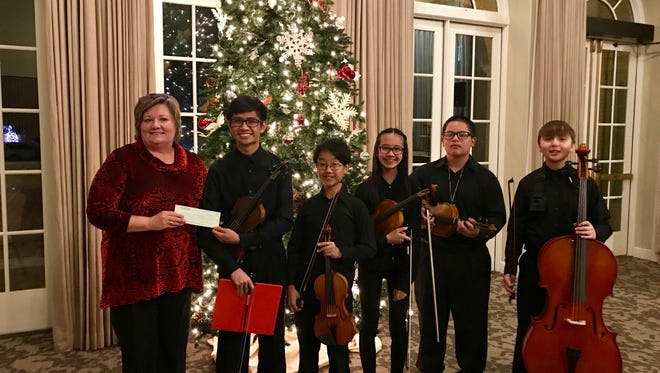 The Senior-Junior Forum enjoyed a Christmas concert by the Wichita Falls Youth Symphony at their annual President's Christmas dinner. SJF President Mary Brasher presented them with a donation on behalf of the SJF. Pictured with her are WFYSO performers From left: Alexis Nicolas, Jun Park, Lauren Nicolas, Elijah Aguon, Trent Roth. SJF was proud to support the youth arts in Wichita Falls.