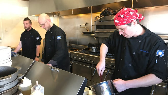 Cooks, right to left, Jeff Schreiber, Eric Homrich and Tyler Hubbard prepare dishes during the lunch rush at Moonstone Bistro in Redding.