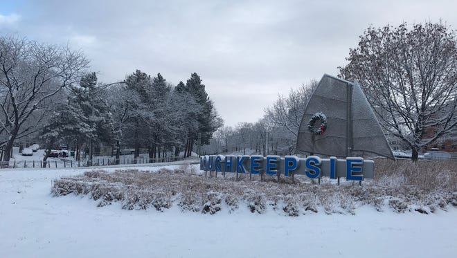 Poughkeepsie sign sits under snow on Christmas morning.