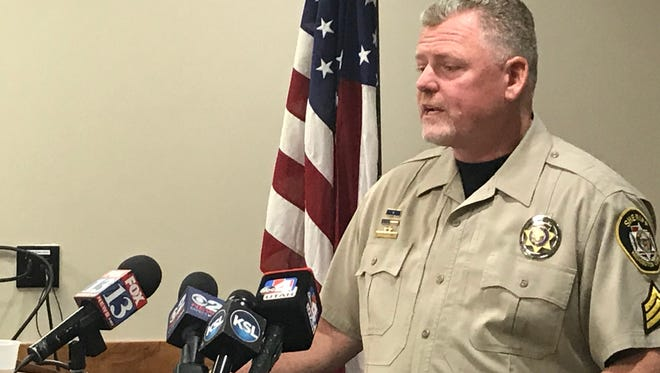 Washington County Sheriff's Office Sgt. Aaron Thompson speaks to reporters Tuesday about an effort to save an 8-year-old boy from drowning in a frozen pond.