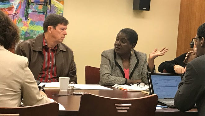 Former Tallahassee City Commissioner Dorothy Inman (R) discusses issues with former Leon County Clerk of Court Bob Inzer Tuesday during a meeting of a citizens group appointed by the City Commission to review candidates for City Attorney.