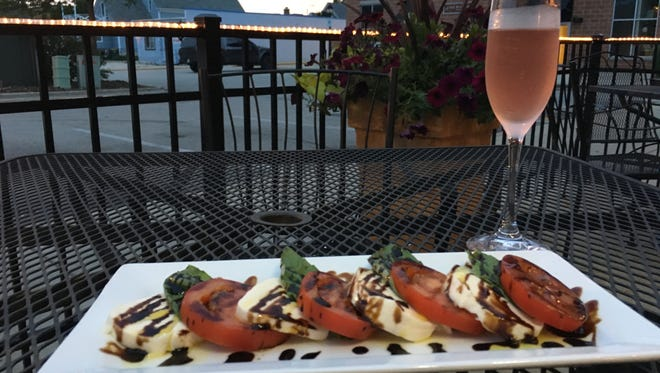 Pourvino's patio is a great place to enjoy a caprese salad and a glass of wine.