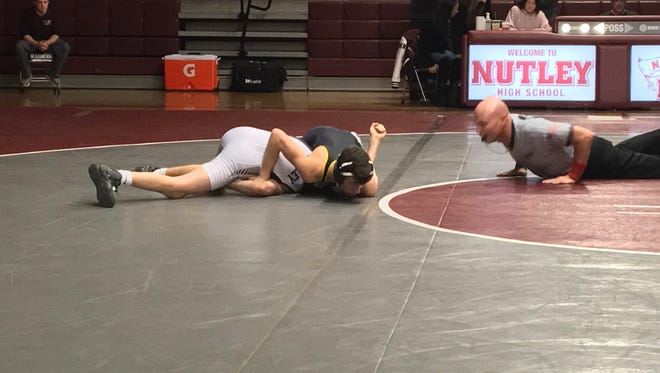 Cedar Grove's Antonio Cuffari (black) gets a pin against Nutley at 106 pounds.