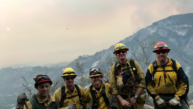 Aumsville firefighters Stormie Morlan, center, and Brad Buchholz, far left, have returned to Oregon after helping quell fires in California