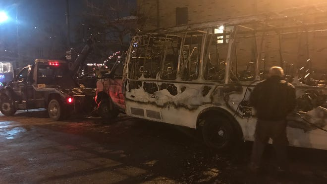 A gutted jitney bus is towed in Cliffside Park on Saturday, Dec. 30, 2017.