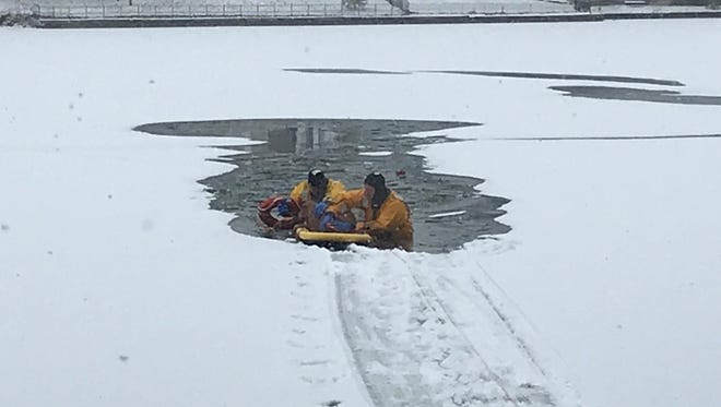 Oaklyn Fire Department Battalion Chief Greg Grudzinski and Capt. Fred Bartling rescued a dog that fell through the ice into Newton Creek on Saturday morning.