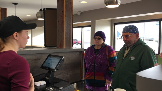 South Lyon residents Theresa and Stuart Taylor place their order at A Good Day Cafe. Employee Bree Taylor (left) no relation waits on the couple.