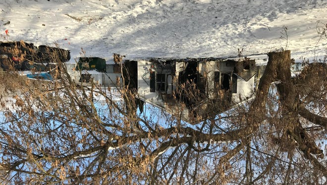 A woman who ran an in-home animal rescue lost her Kinneville Road home and 34 dogs and cats that were in the home in a fire Tuesday night.