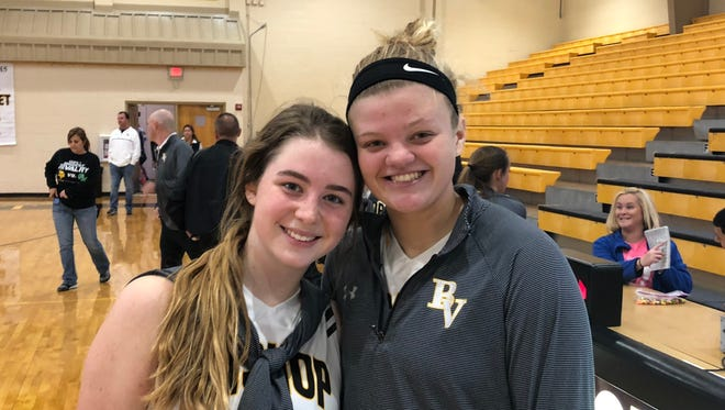 Bishop Verot juniors Claire Woolam (left) and Charlotte Terry scored their 1,000th career points Saturday in a win over Cypress Lake.