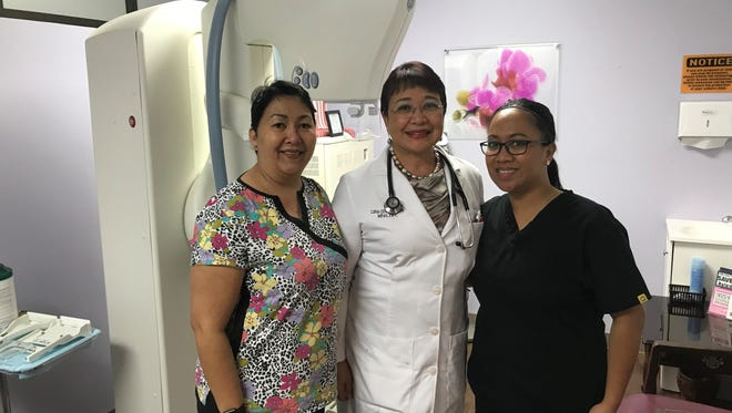 Rrom right, Ruth Williams; Lina Quan-Aston; and Jean Sabina next to the digital mammography equipment at FHP Health Center's Digital Mammography Unit.
