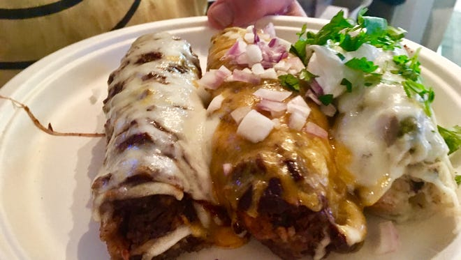 From left: pork tamale, beef tamale and chicken tamale all come in an order at Elwood's Shack through the month.